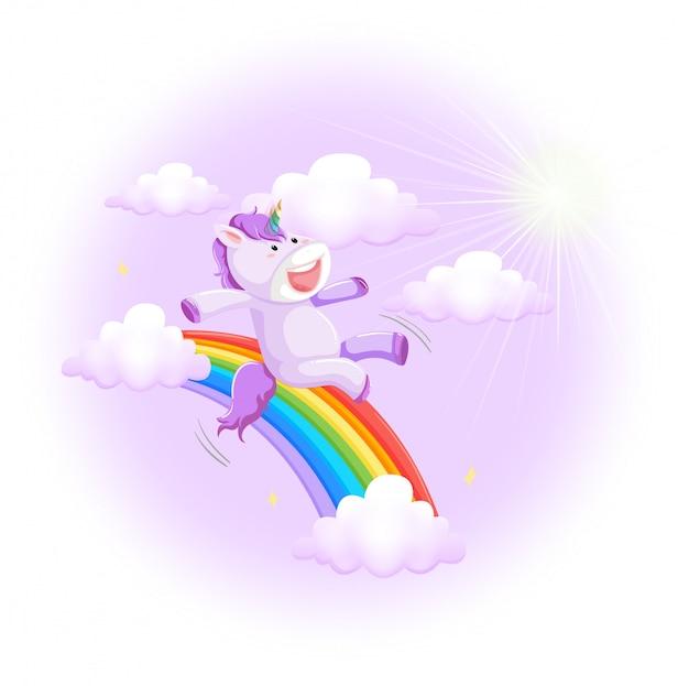 Unicorno di fantasia che scorre lungo un arcobaleno