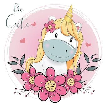 Unicorno simpatico cartone animato con fiori con sfondo rosa