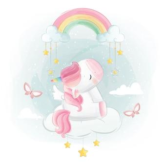 Unicorno sveglio che si siede sotto l'arcobaleno