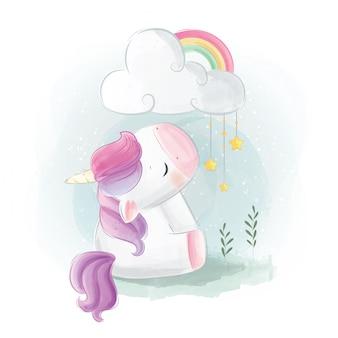 Unicorno sveglio che si siede sotto la nuvola stellata