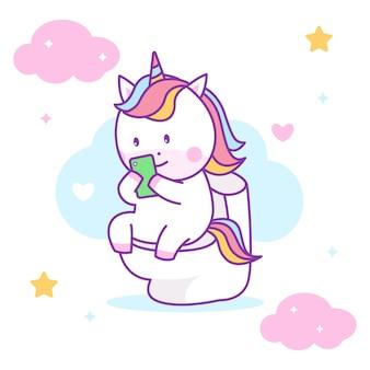Unicorno sveglio che si siede sull'armadio e che gioca smartphone