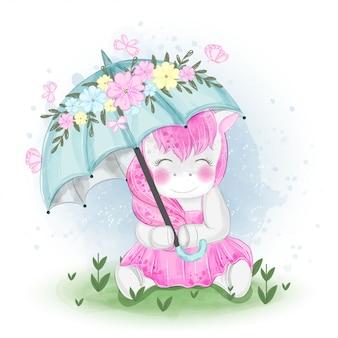 Unicorno sveglio con l'illustrazione dell'ombrello