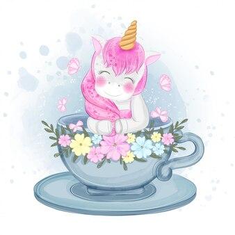 Unicorno sveglio in un'illustrazione del tè della tazza