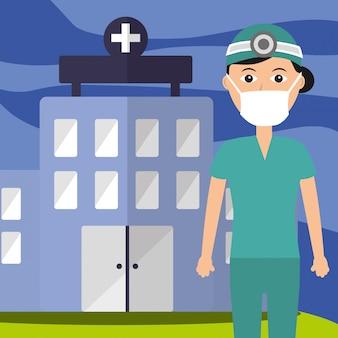 Uniforme del medico e maschera personale edificio ospedaliero professionale