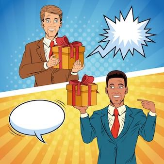 Uomini d'affari di arte di schiocco con il fumetto delle scatole di regalo