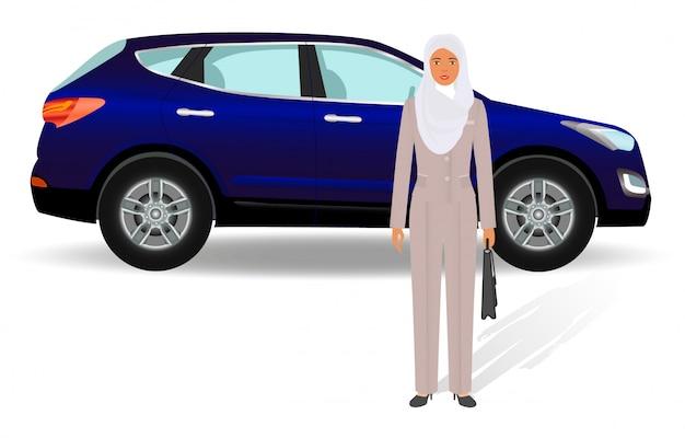 Uomini d'affari . donna di affari araba che sta su un'automobile di lusso.