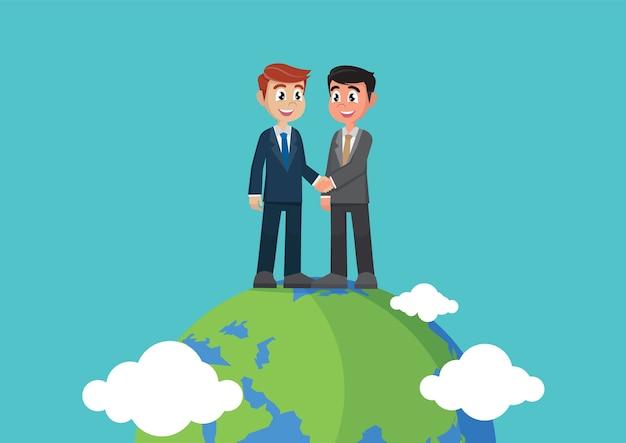 Uomini d'affari si stringono la mano al globo.