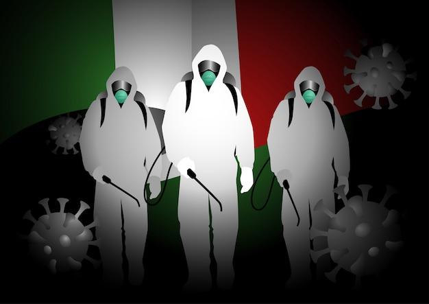 Uomini in abiti ignifughi che trasportano spray disinfettanti con la bandiera dell'italia sullo sfondo