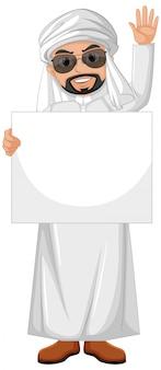 Uomo adulto arabo che indossa il costume arabo e che tiene bandiera in bianco