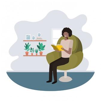 Uomo afro con libro nel personaggio avatar soggiorno