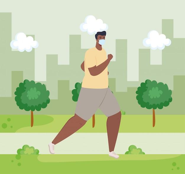 Uomo afro in esecuzione indossando maschera medica all'aperto, prevenzione coronavirus covid 19