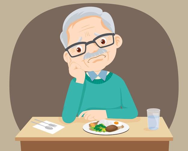 Uomo anziano annoiato con il cibo