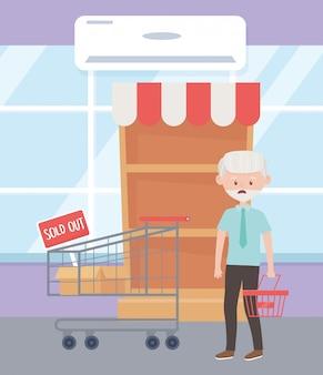 Uomo anziano con acquisto dell'alimento in eccesso dello scaffale vuoto del mercato del carrello del cestino