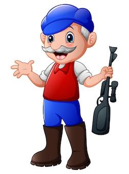 Uomo cacciatore che tiene la sua pistola