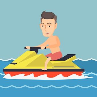 Uomo caucasico che guida su uno scooter acquatico nel mare
