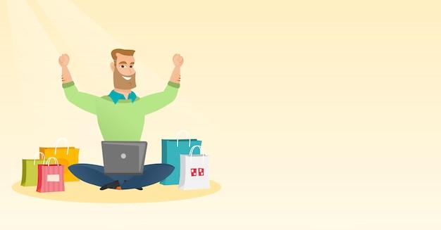 Uomo caucasico che utilizza un laptop per lo shopping online.