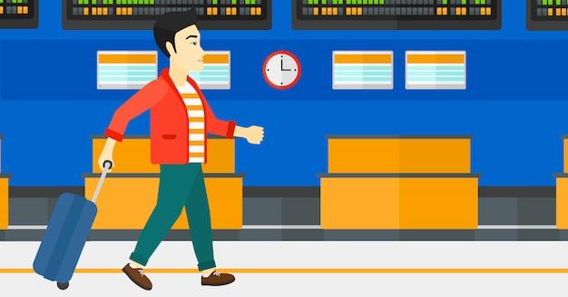 Uomo che cammina con la valigia