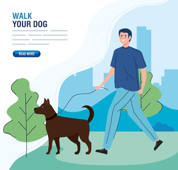 Uomo che cammina il tuo cane nel parco