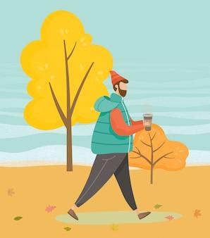Uomo che cammina in autumn park, tempo caldo autunno