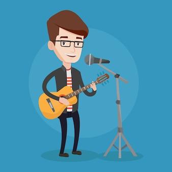Uomo che canta nel microfono e suonare la chitarra.