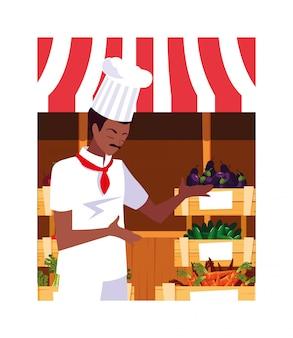 Uomo che cucina, chef in uniforme bianca
