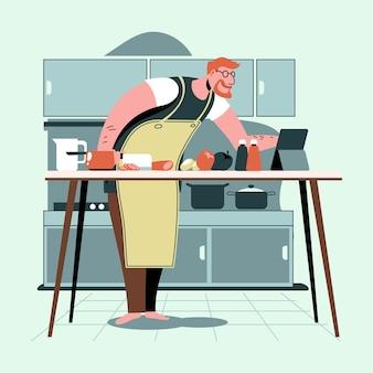 Uomo che cucina una nuova ricetta da internet