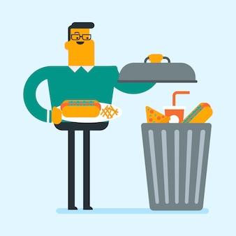 Uomo che getta cibo spazzatura nel cestino.