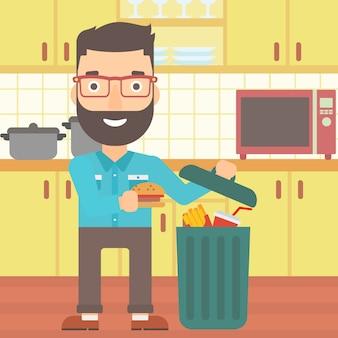 Uomo che getta cibo spazzatura.
