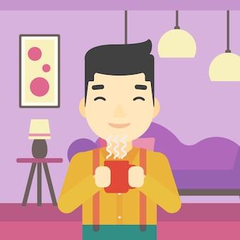 Uomo che gode di una tazza di caffè caldo.