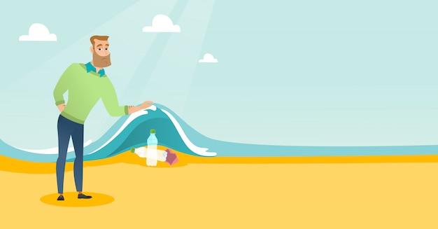 Uomo che mostra le bottiglie di plastica sotto l'onda del mare.