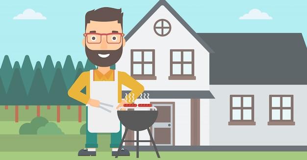 Uomo che prepara il barbecue.