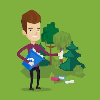 Uomo che raccoglie immondizia in foresta.