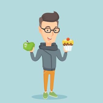Uomo che sceglie fra la mela e il bigné.