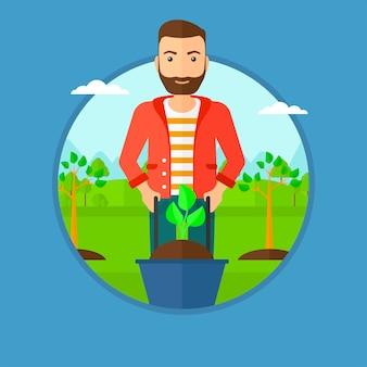 Uomo che spinge la carriola con la pianta.