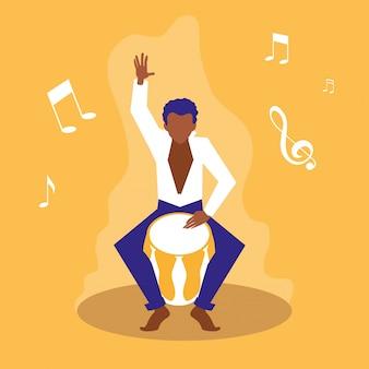Uomo che suona gli artisti del tamburo bongo