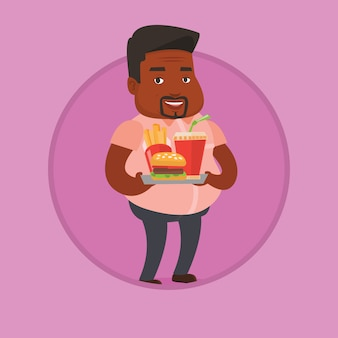 Uomo che tiene il vassoio pieno di fast food.
