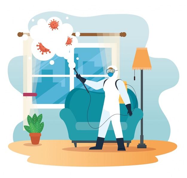 Uomo con il vestito protettivo che spruzza finestra domestica con