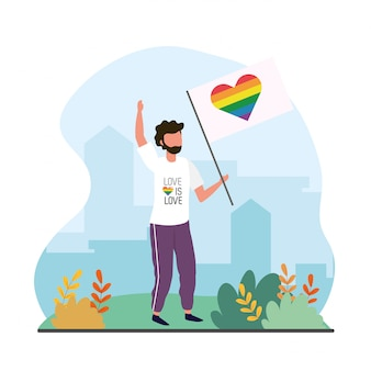 Uomo con la bandiera dell'arcobaleno del cuore alla celebrazione del lgtb