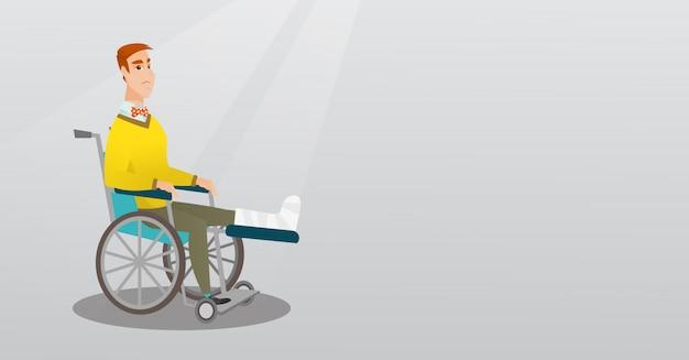 Uomo con la gamba rotta che si siede in una sedia a rotelle.