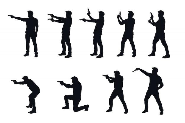 Uomo con la pistola silhhouette nel set