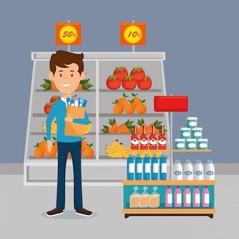Uomo con la spesa del supermercato nella borsa della spesa