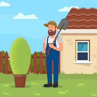 Uomo con pala in giardino. giardiniere in uniforme.