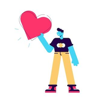 Uomo con un grande cuore rosso nelle mani. l'uomo tiene il cuore.