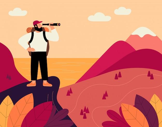 Uomo con zaino e cannocchiale, viaggiatore in piedi sulla cima della montagna e guardando sulla valle.