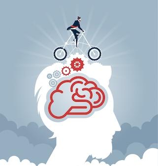 Uomo d'affari che guida una bici con gli ingranaggi sulla testa. Vettore concetto aziendale
