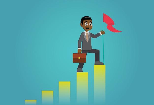 Uomo d'affari africano che tiene una bandiera in cima al grafico della colonna.
