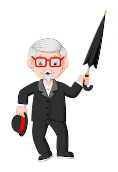Uomo d'affari anziano senior con l'ombrello