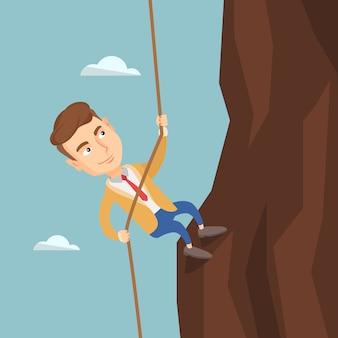 Uomo d'affari arrampicata sulla montagna.