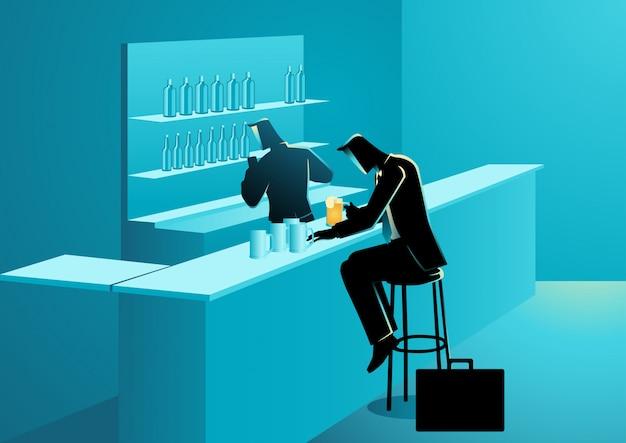 Uomo d'affari che beve in una barra