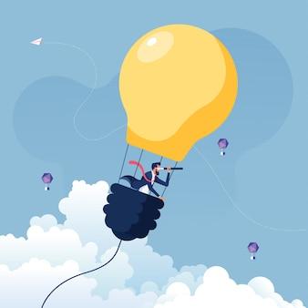 Uomo d'affari che cerca le opportunità nel concetto della lampadina-affare della mongolfiera